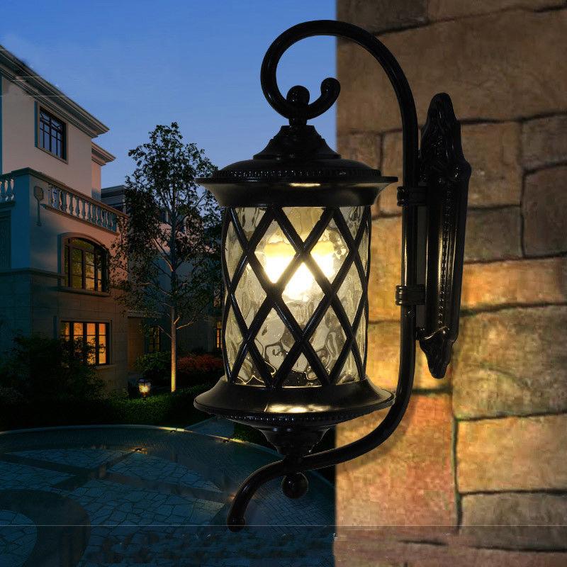 Newest Black/brass Lantern Stone Metal Glass Cylinder Outdoor Regarding Ciotti Black Outdoor Wall Lanterns (View 15 of 20)