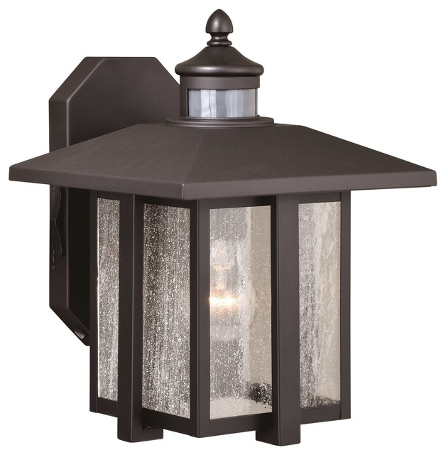 Ranbir Oil Burnished Bronze Outdoor Wall Lanterns With Dusk To Dawn For Well Known Hedron Bronze Motion Sensor Dusk To Dawn Outdoor Mission (View 11 of 20)