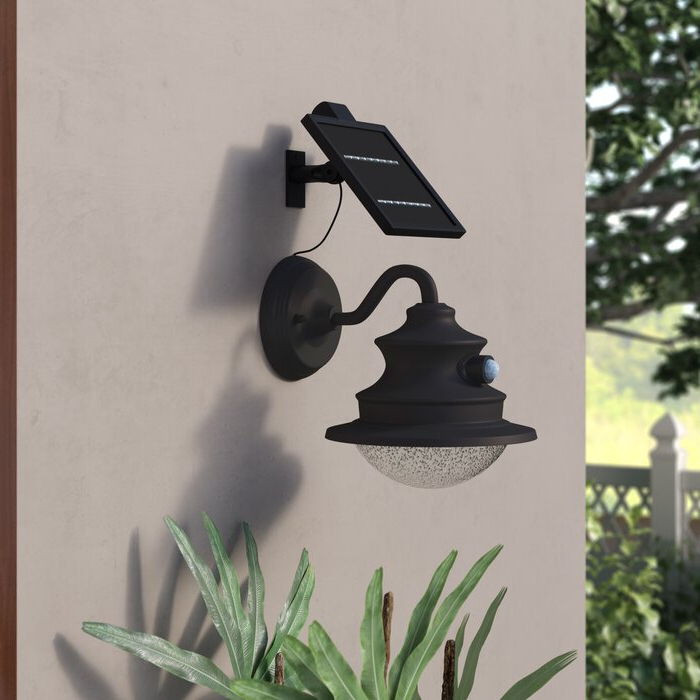 Red Barrel Studio® Jiera Brown Solar Powered Integrated Pertaining To Newest Edenfield Water Glass Outdoor Wall Lanterns With Dusk To Dawn (View 13 of 20)