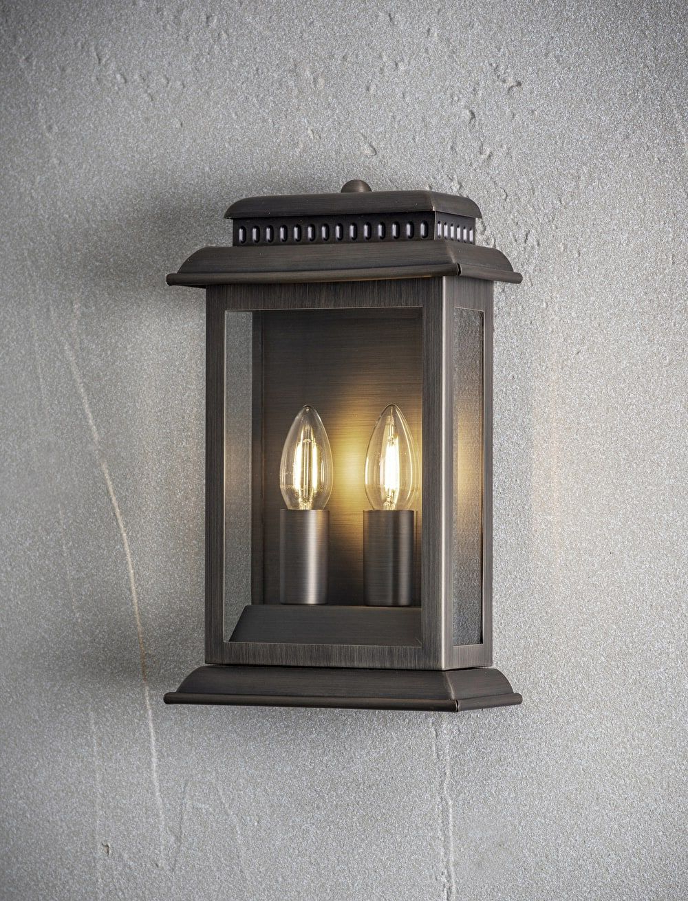 Trendy A Plated Bronze Outdoor Wall Light Matched With Two Candle Within Chicopee 2 – Bulb Glass Outdoor Wall Lanterns (View 13 of 20)